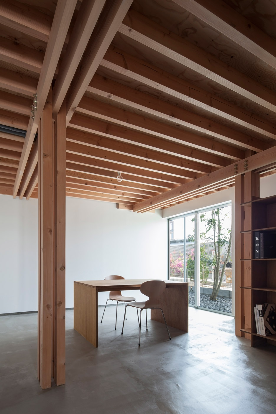 FT Architects 4 Columns house features a traditional timber frame