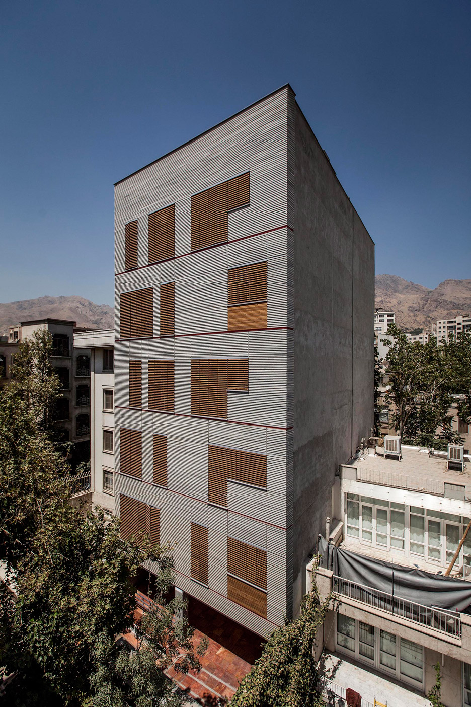 Ayeneh office gives tehran apartments a textured facade for Local residential architects near me