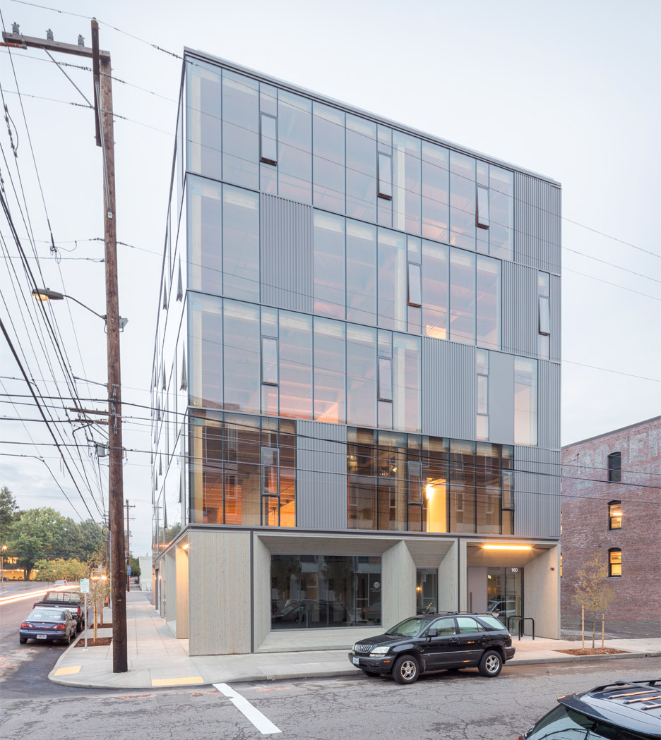 Glass Facade Reveals Timber Structure Of Frame Work