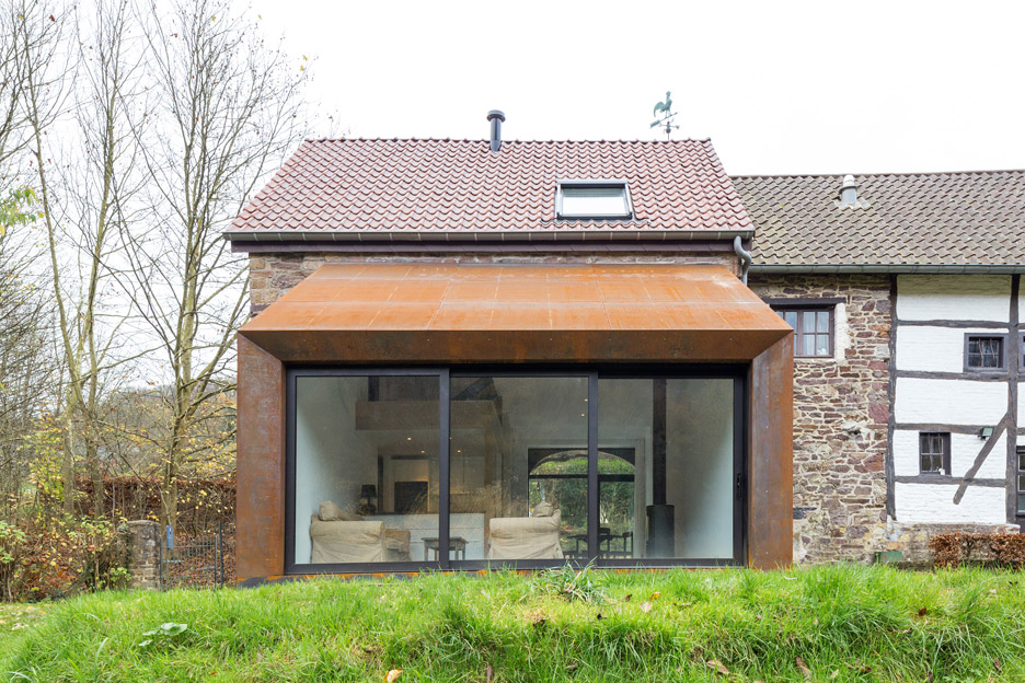 Puzzles Architecture adds rusty steel extension to an old Belgian barn