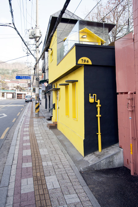 North Gate Salon fashion boutique features yellow walls and a black bird at the entrance