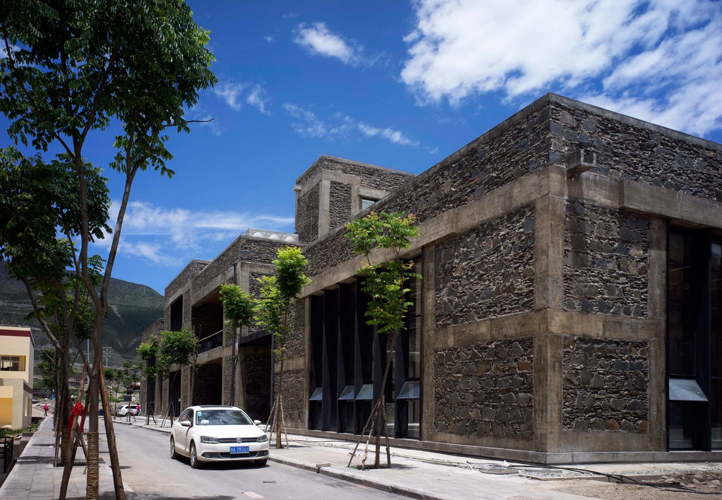 Tibetan school in China is clad is stone to match mountainous setting