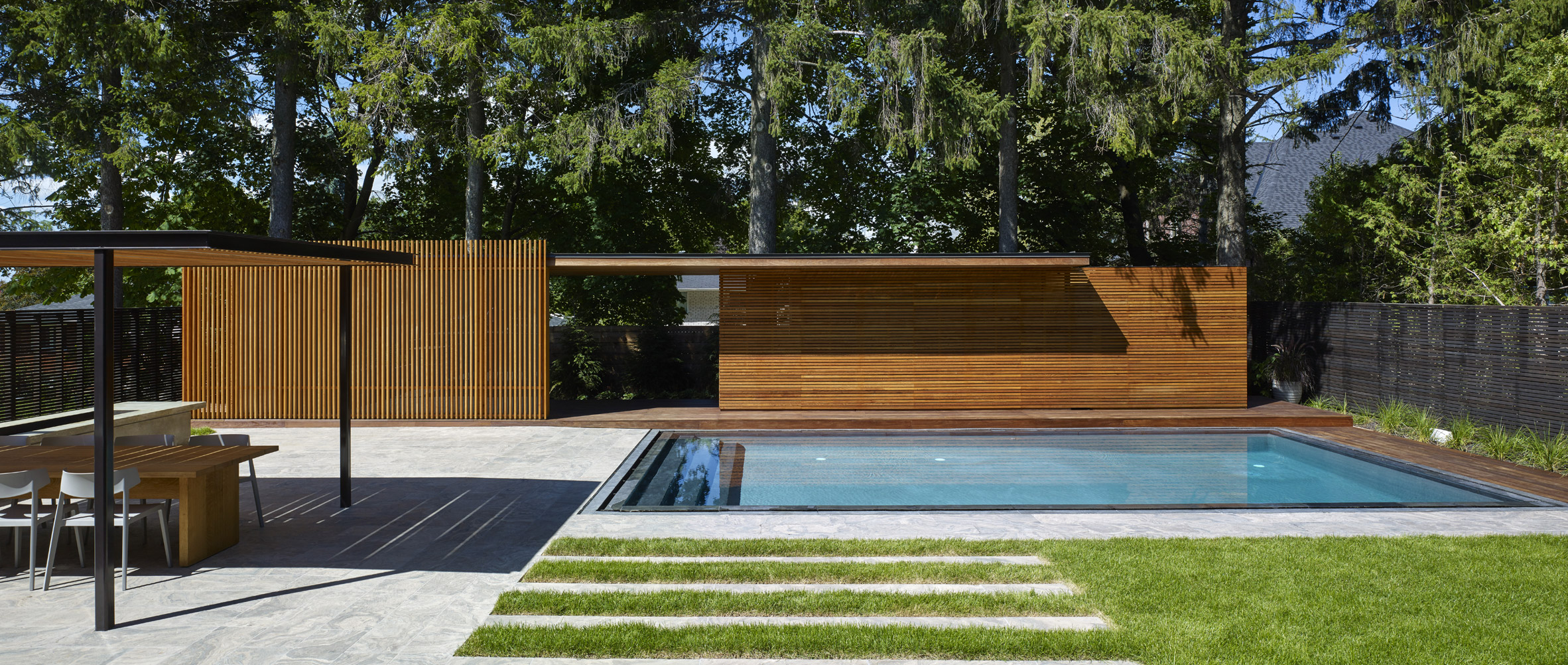 Wooden pool house by Amantea Architects provides privacy for Canadian family