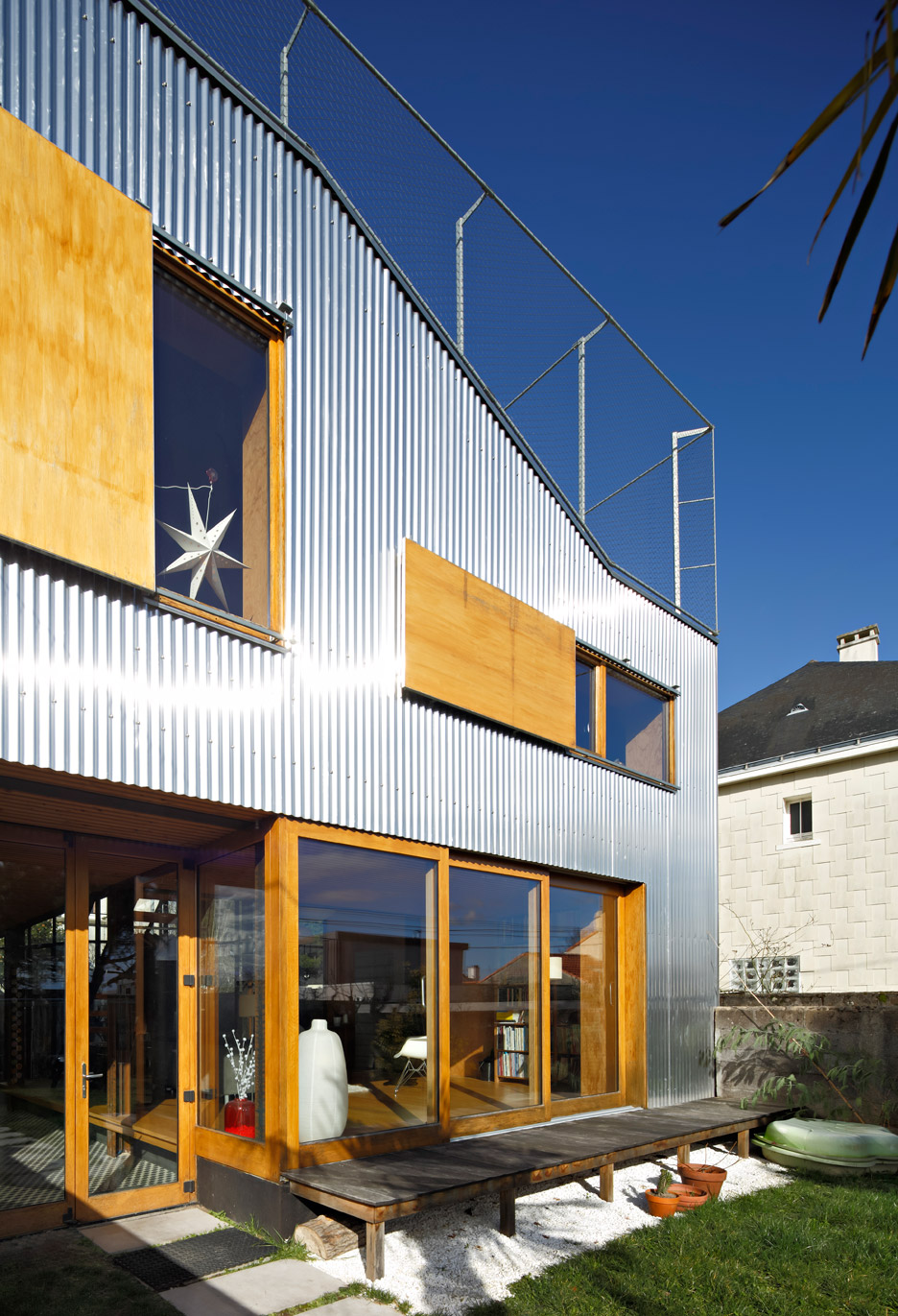 Mabire-Reich\'s Landscape House features metal walls and a sloping ...