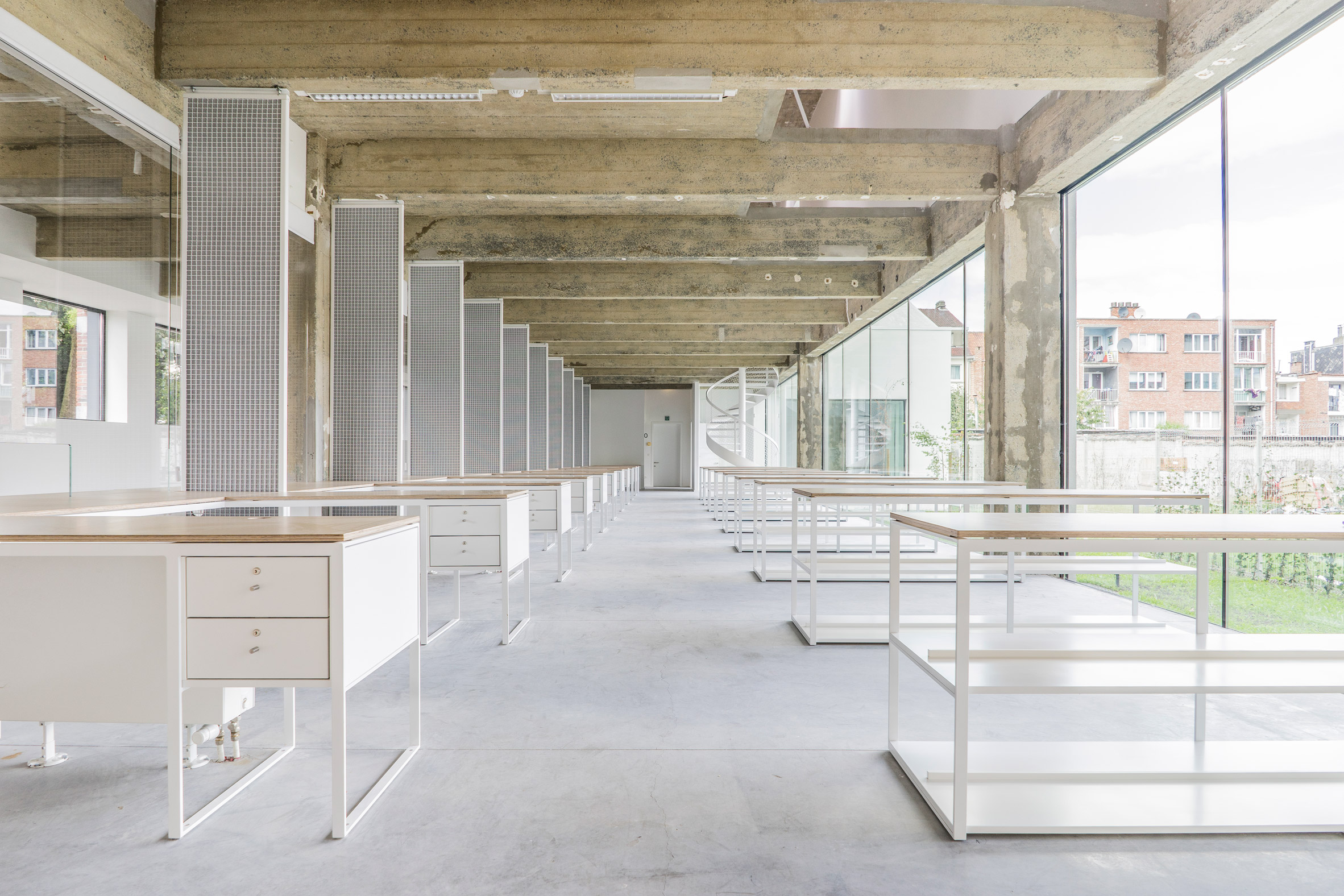 Cigarette factory in Brussels converted into city hall by trio of Belgian architects
