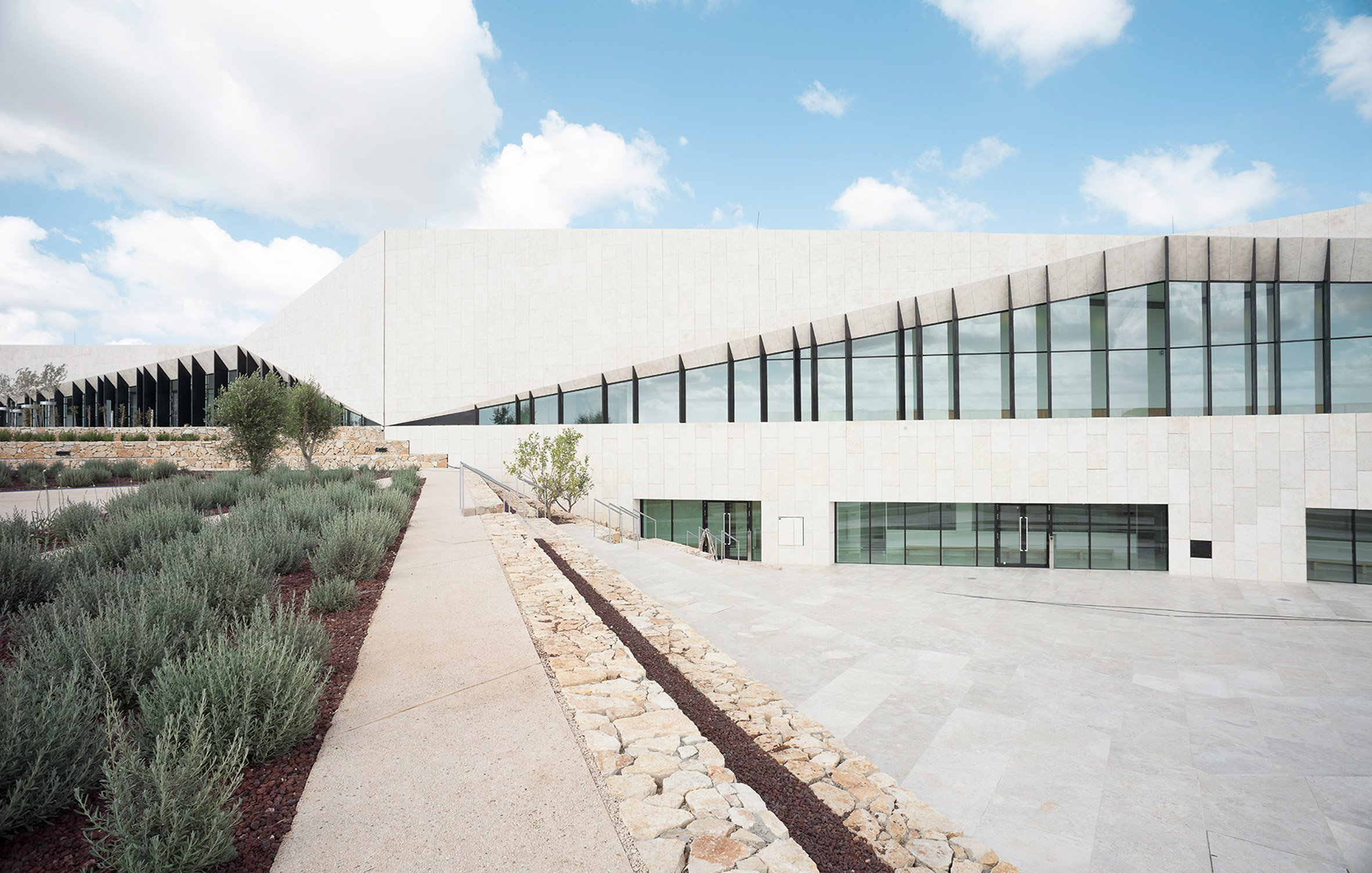Heneghan Peng sets limestone-clad Palestinian Museum among angular landscaped terraces