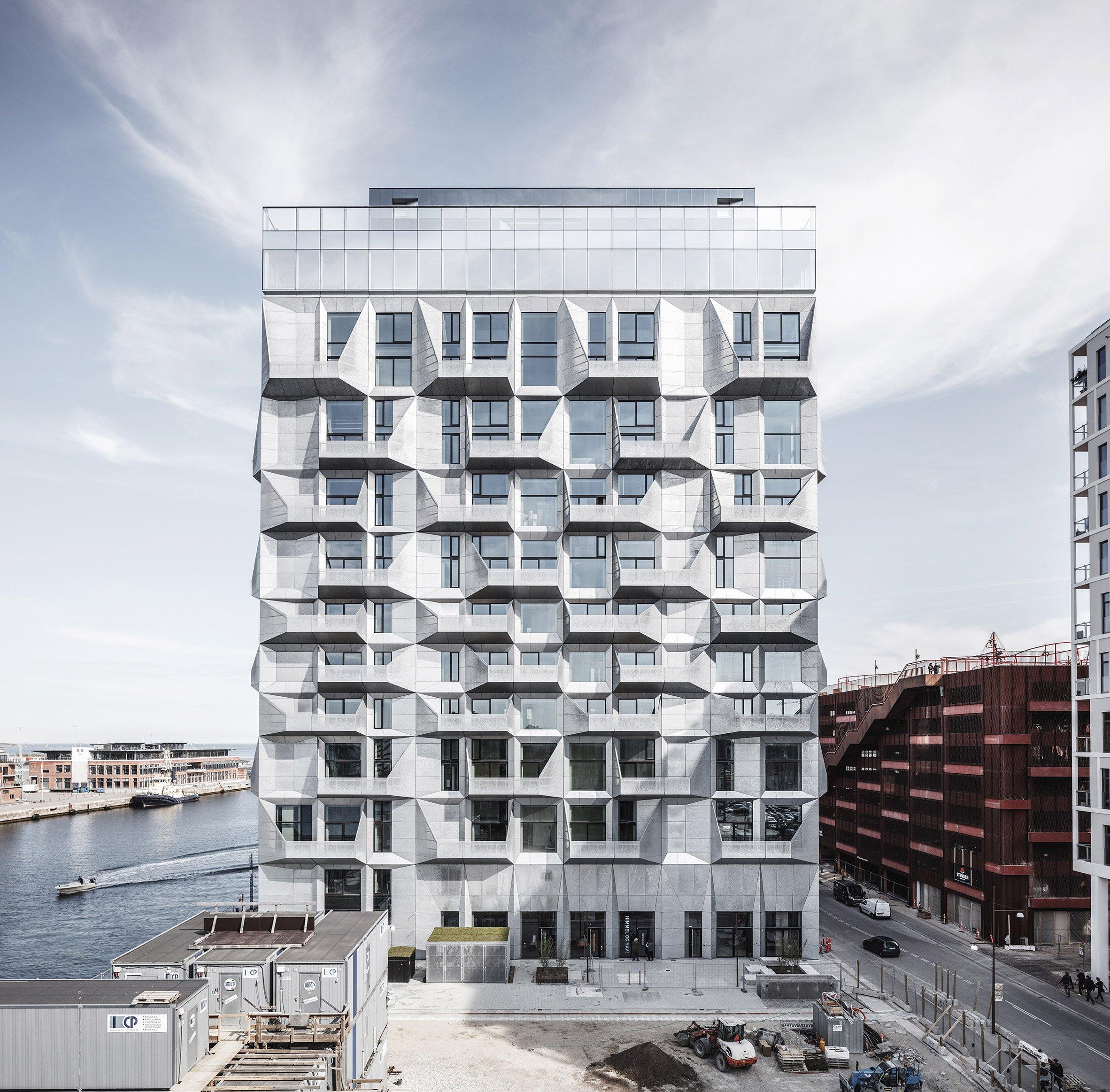 COBE transforms Copenhagen grain silo into apartment block with faceted facades