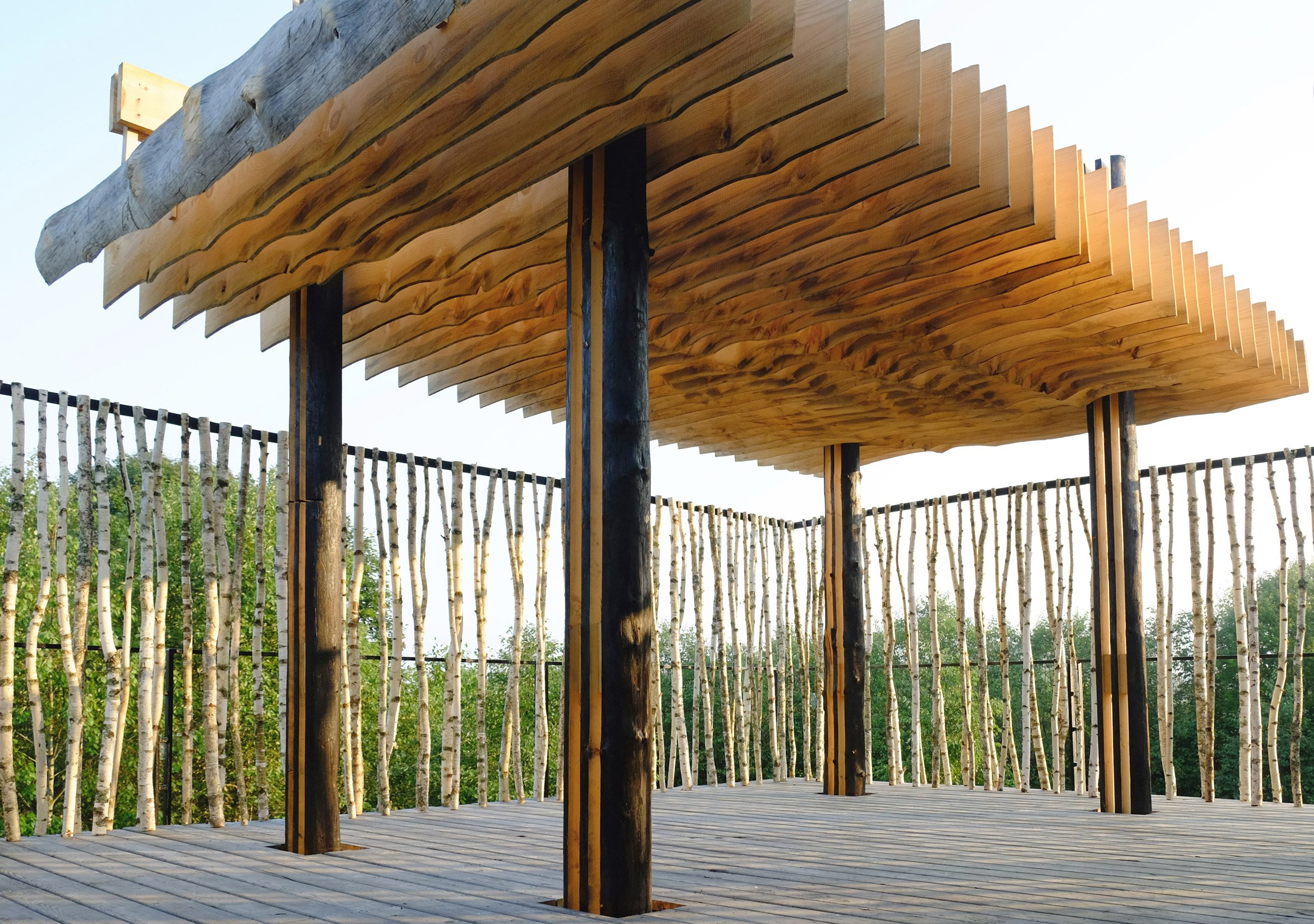 Slices of timber align to form roof of outdoor classroom near Moscow