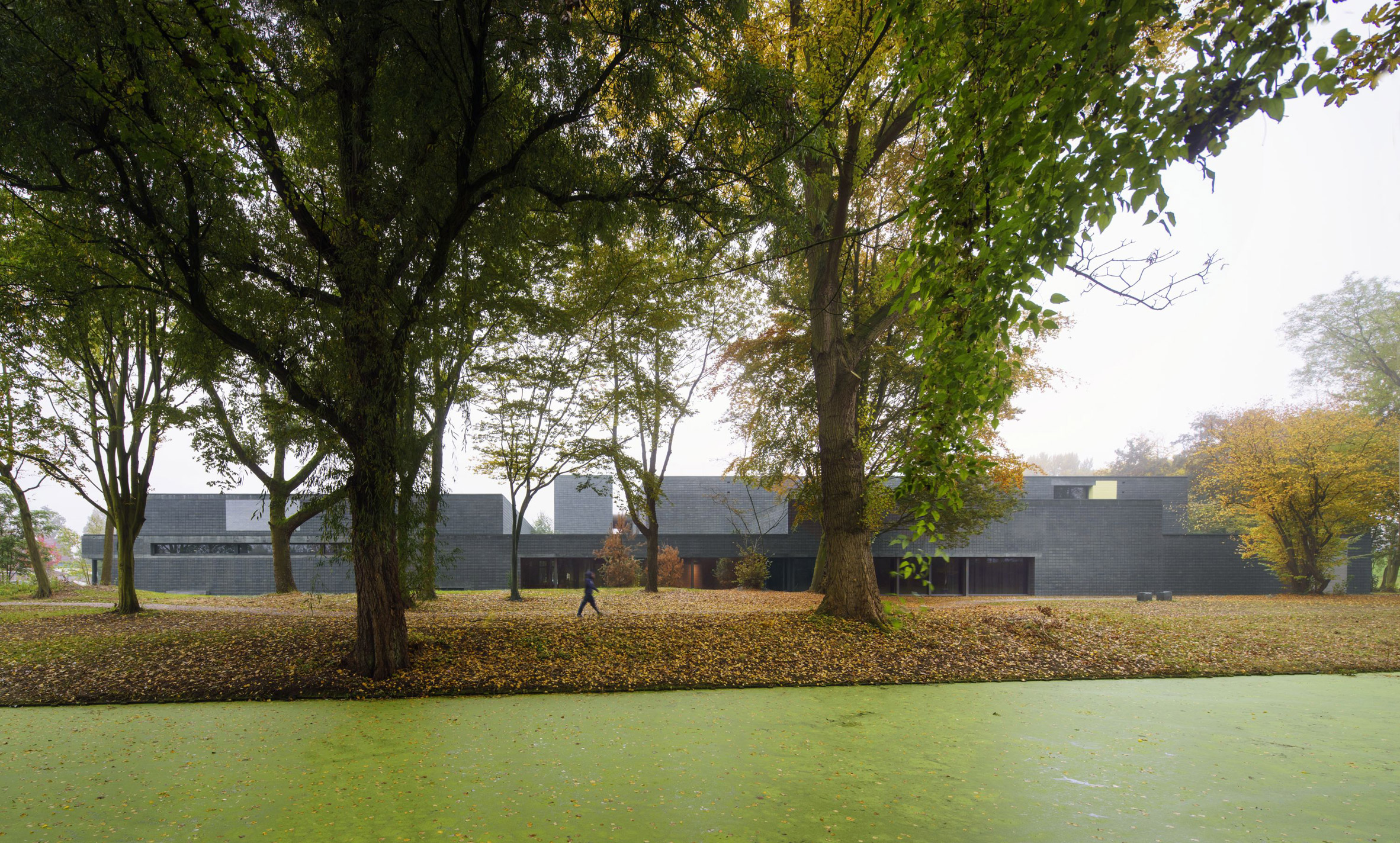 Koen van Velsen Architects uses green-grey brickwork for sports centre near Rotterdam