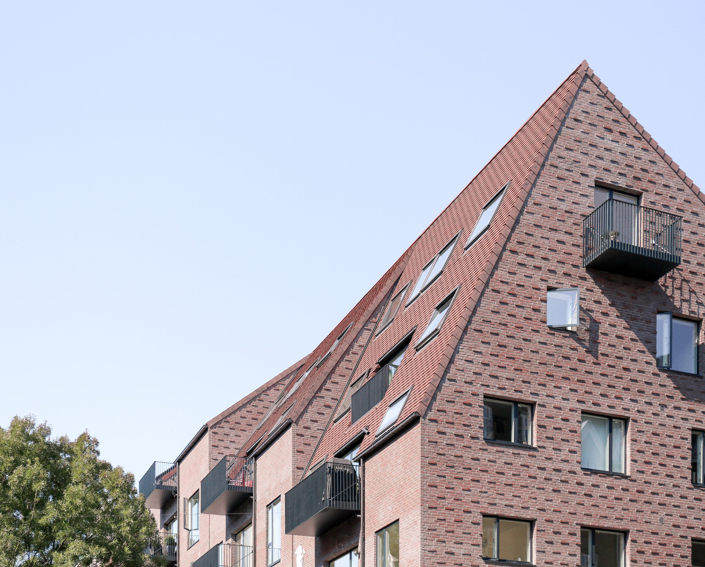 EFFEKT's Thurøhus apartments feature textured brick facades and a staggered roof
