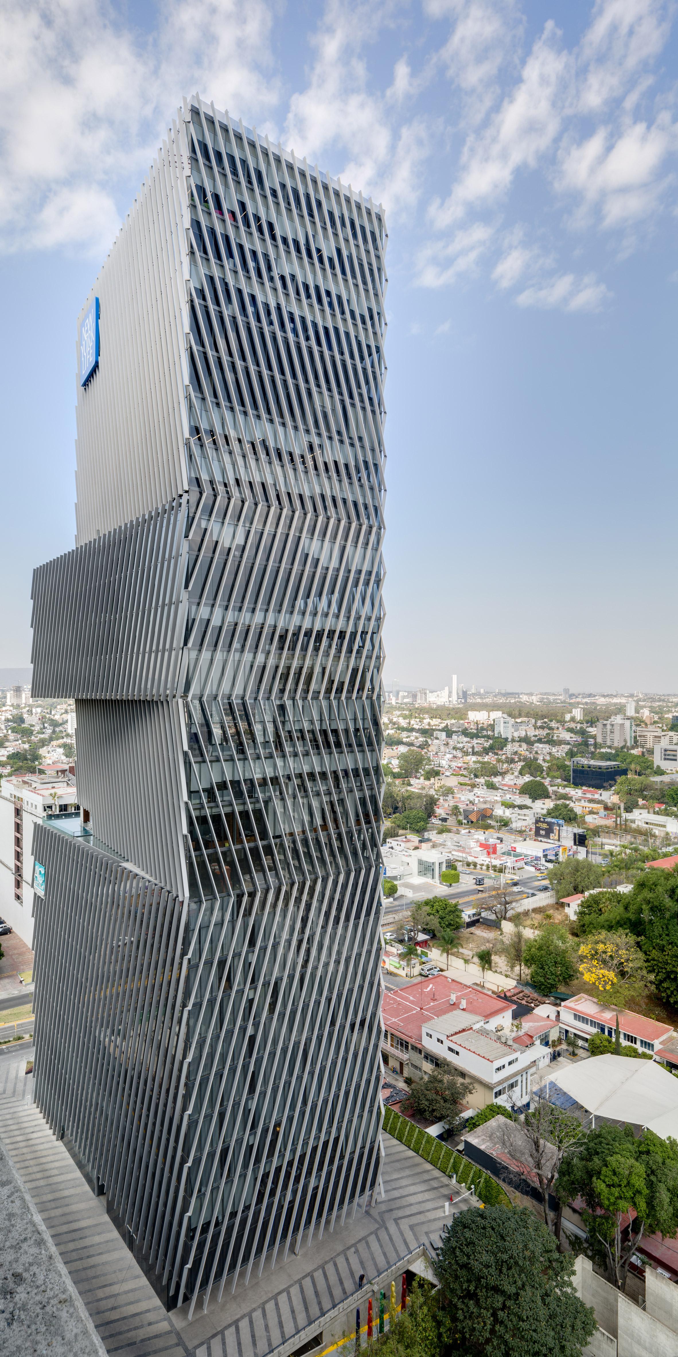Angled louvres shade glass skyscraper in Guadalajara by Sordo Madelano Arquitectos