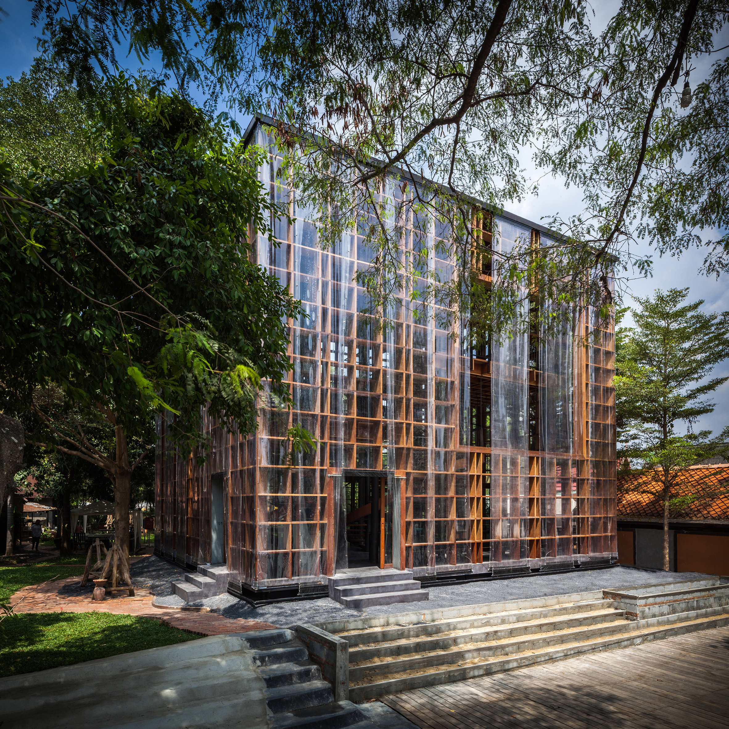 Bangkok Project Studio builds riverside wine bar with latticed plywood walls in Thailand