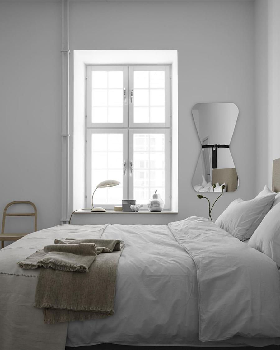 a bedroom in soft, natural tones