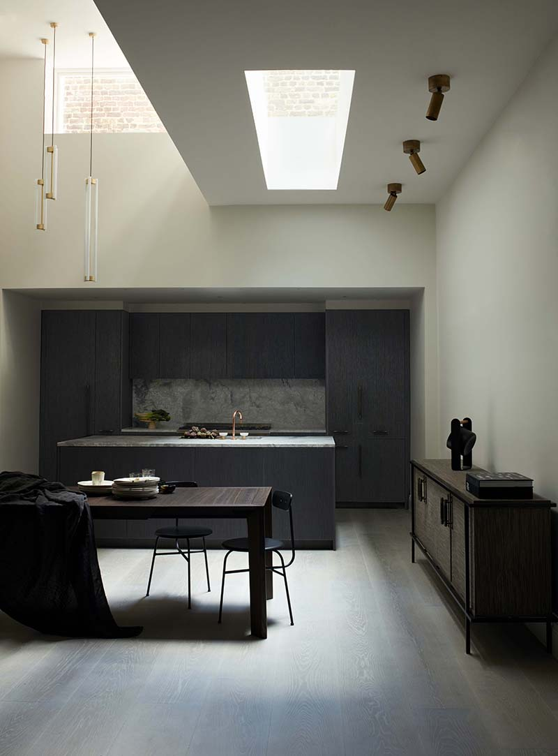 a dark kitchen with skylights