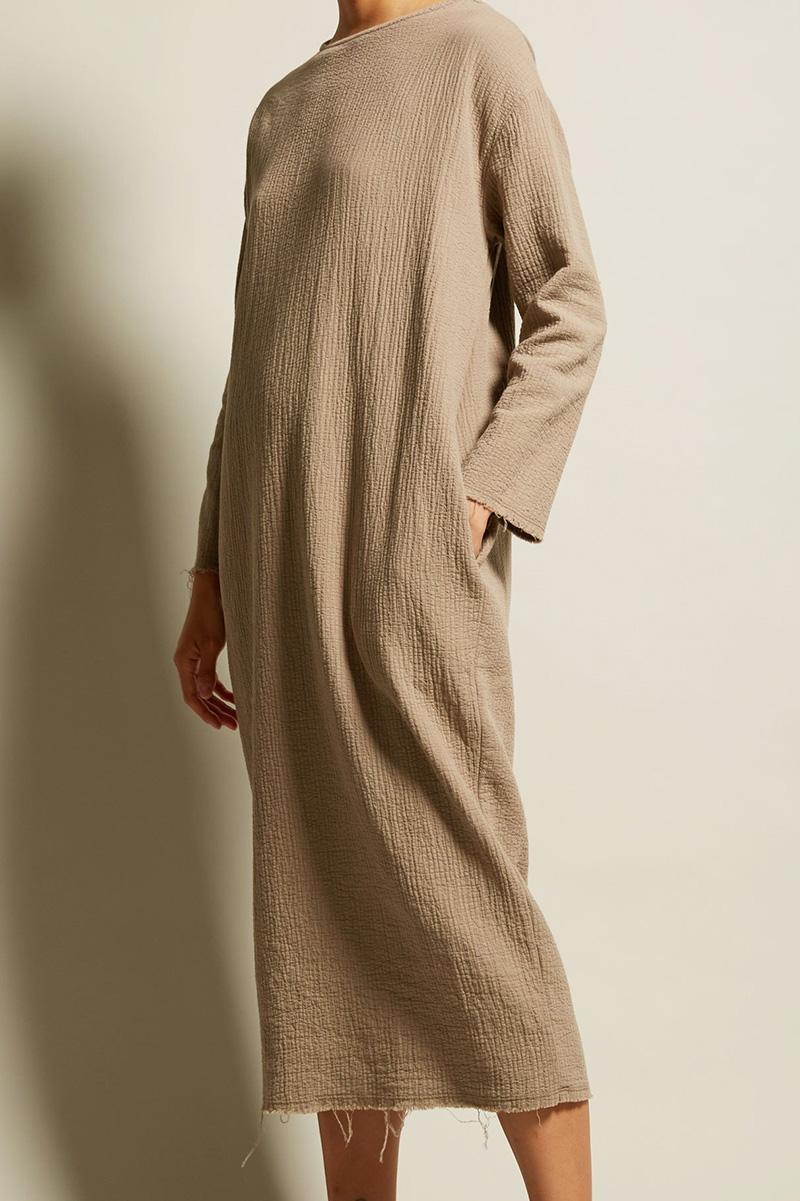 a dress with an undone hem