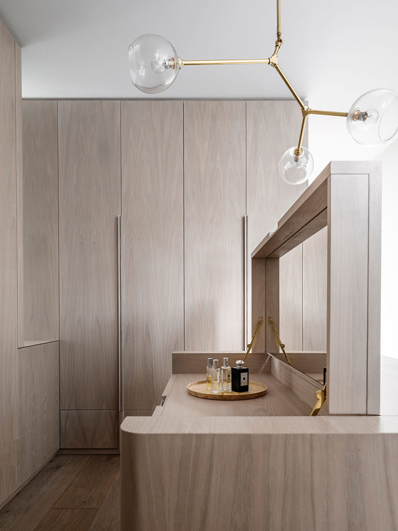 a minimal oak closet