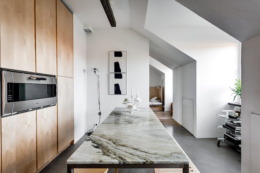 a kitchen of natural wood and steel