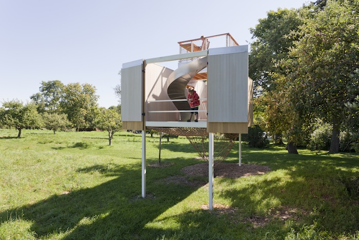 The Playful Treehouse With A Slide And Climbing Net