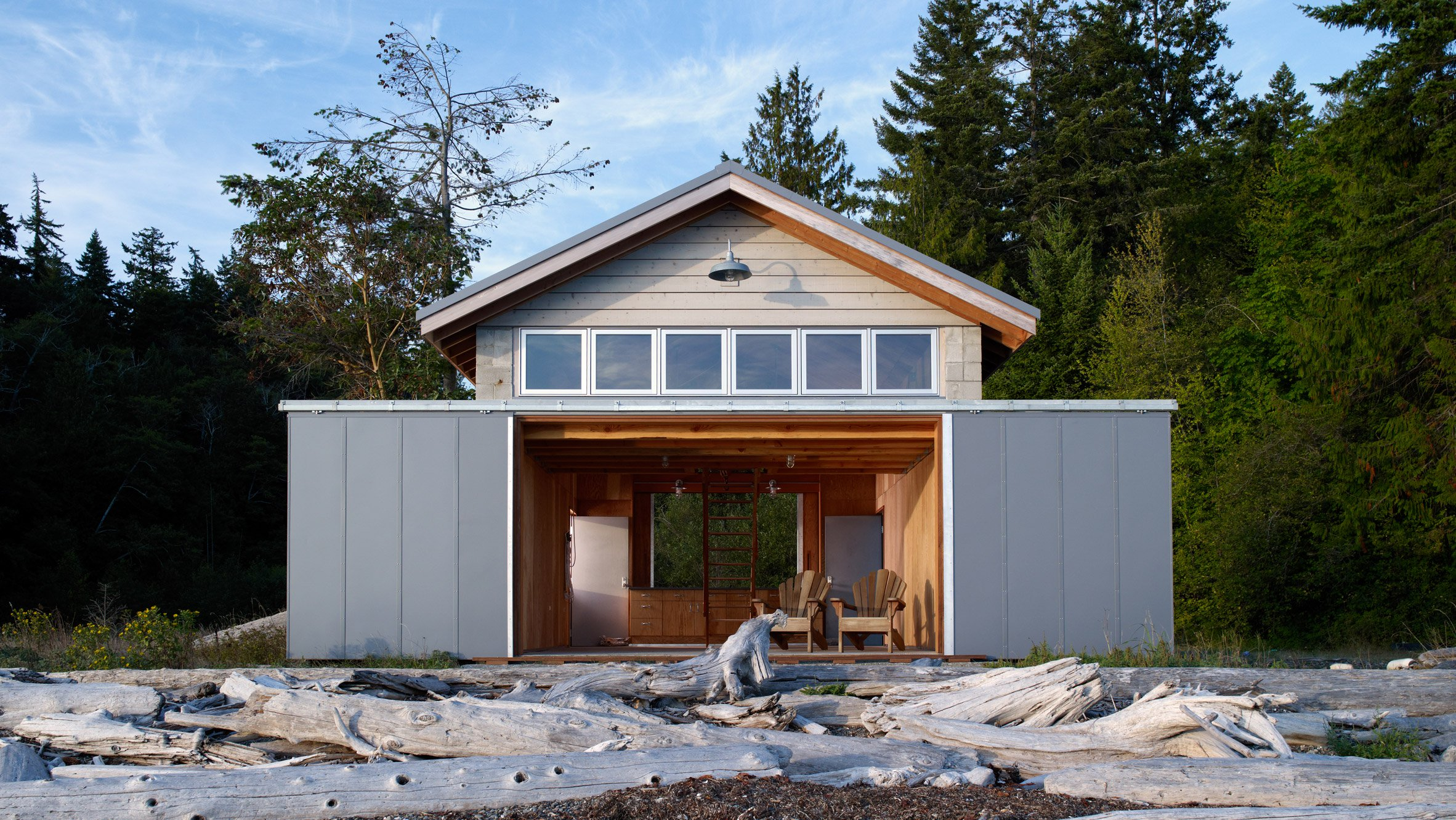 Traditional Washington boathouse by HoedemakerPfeiffer offers sweeping coastal views
