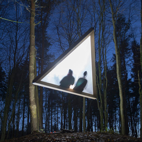 Floating pyramid and wooden tunnel built in the woods by Architectural Association students