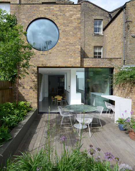 Jimi House by Paul Archer Design features round window inspired by abstract art
