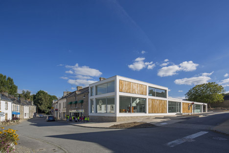 French village library by Studio 02 Architectes presents a gridded facade of wood and glass