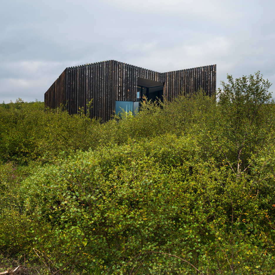 Rural Icelandic cottages by PK Arkitektar have turf roofs and burnt timber cladding