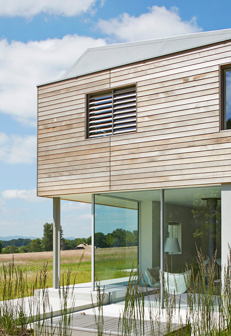 Sussex House by Wilkinson King Architects boasts cedar-clad walls and a ridged roof