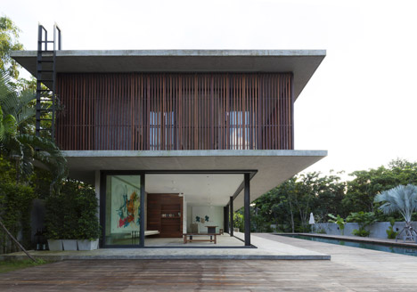 Slatted timber screens shade poolside residence in Thailand by Architect Kidd