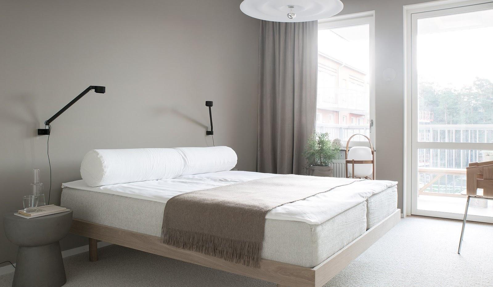 A peaceful bedroom in pale shades
