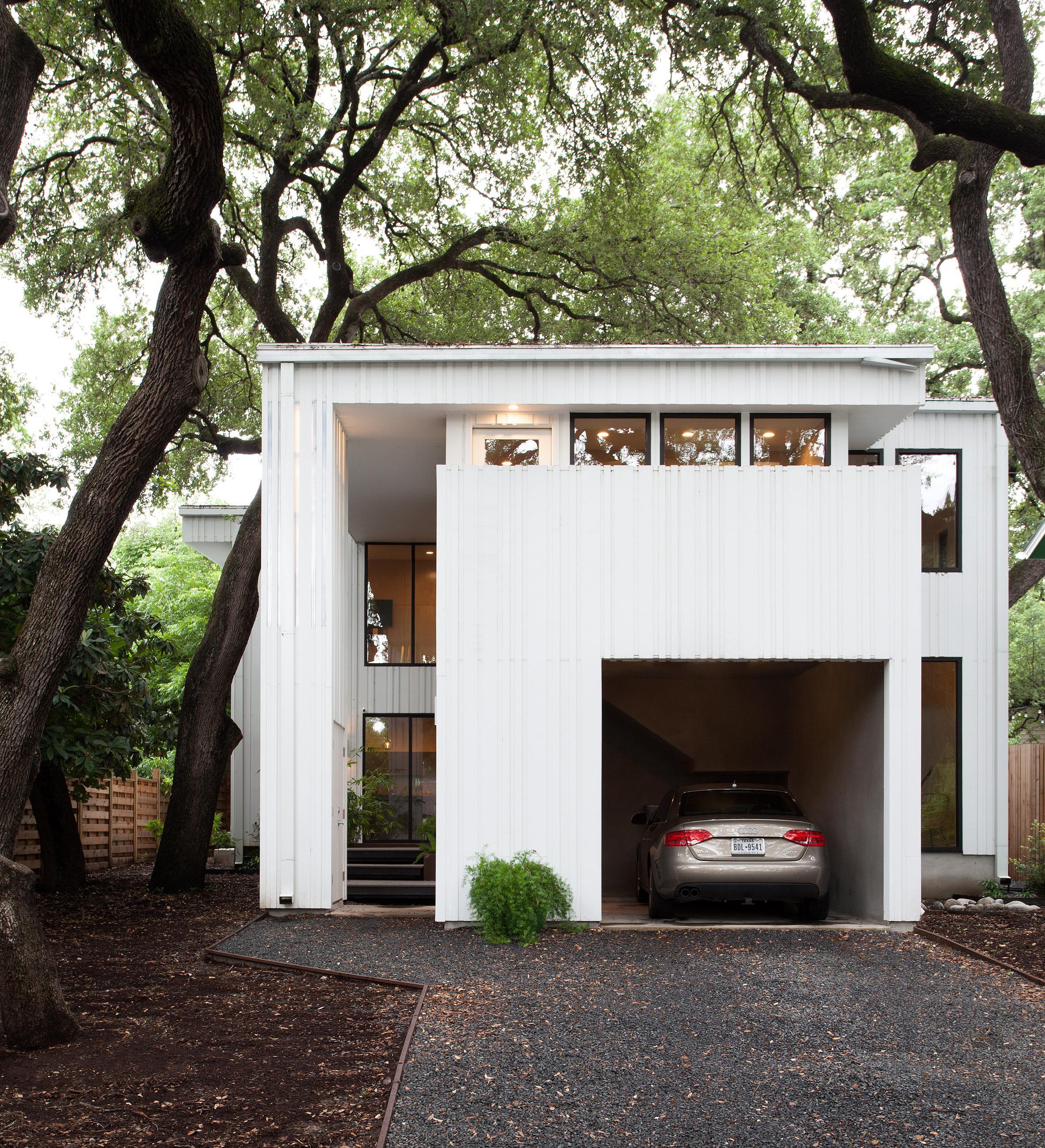 Vertical strips surround white Barcode House in Austin by Webber + Studio