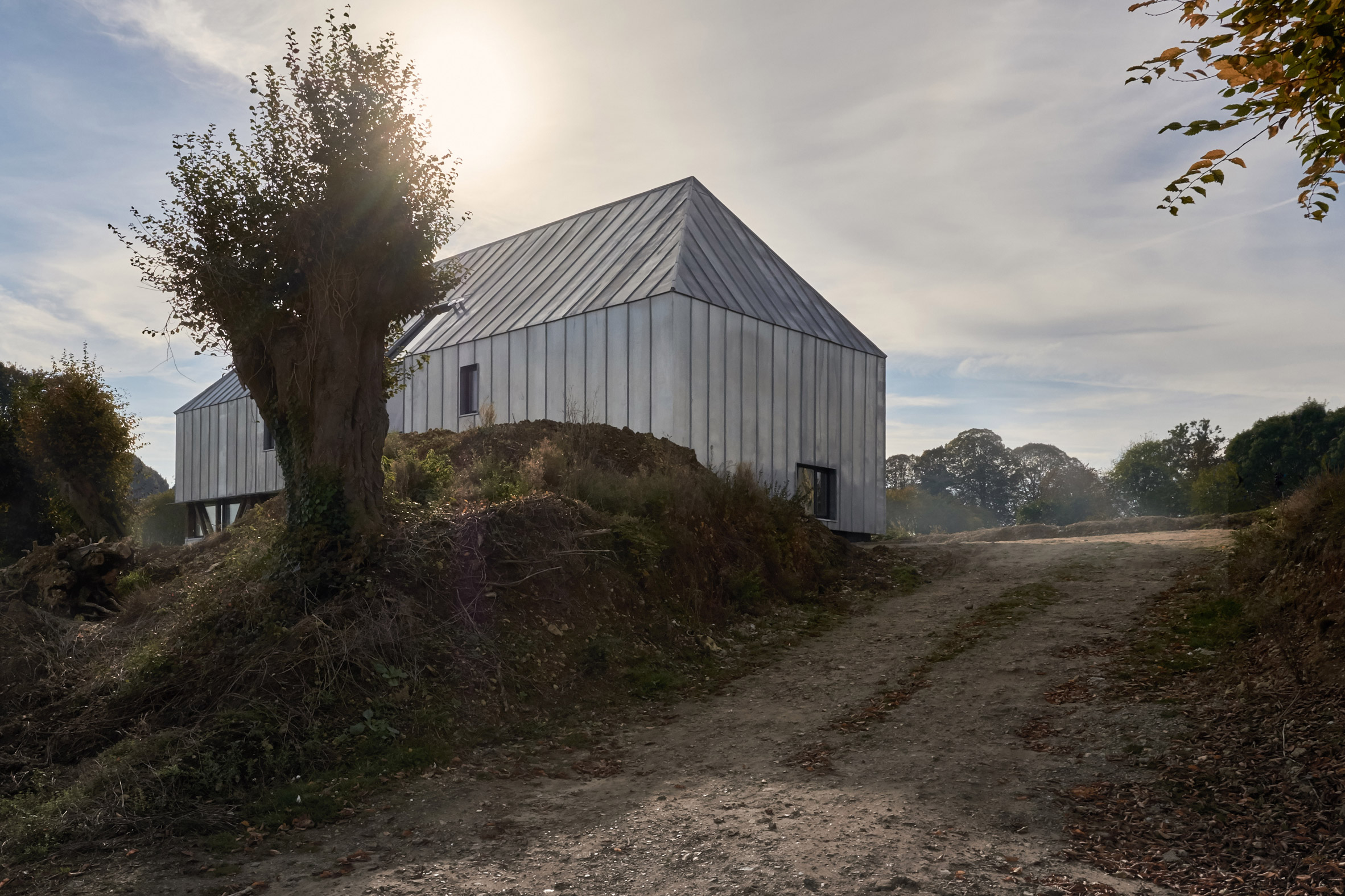 Antonin Ziegler covers abandoned barn in zinc plates to create rustic home in northern France