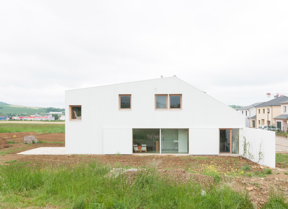 "Asymmetric French house designed by GENS as a collage of ""banal components"""