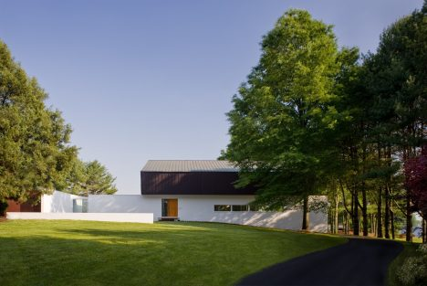Robert Gurney's waterfront Buisson Residence is capped with a folded copper roof