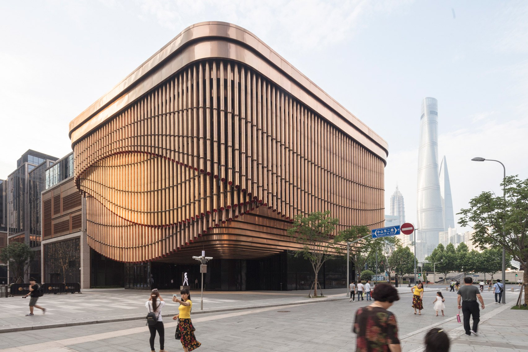 Foster and Heatherwick complete Shanghai theatre with curtain-like facade