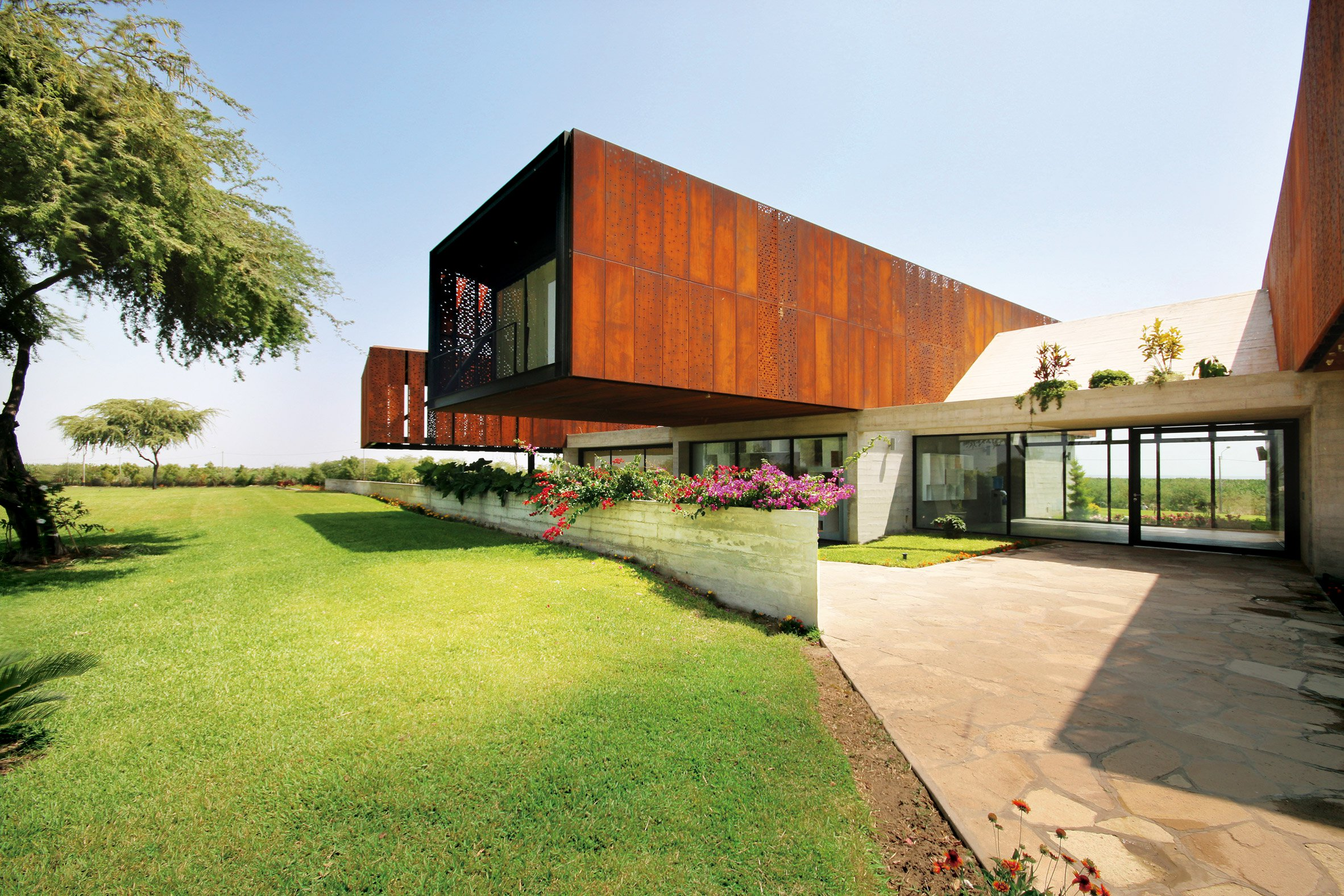 Cheng + Franco cantilevers trio of Corten-clad volumes from rural Peruvian house