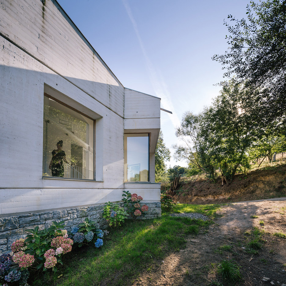 PYO Arquitectos transforms Spanish farmstead with board-marked concrete and pale stone