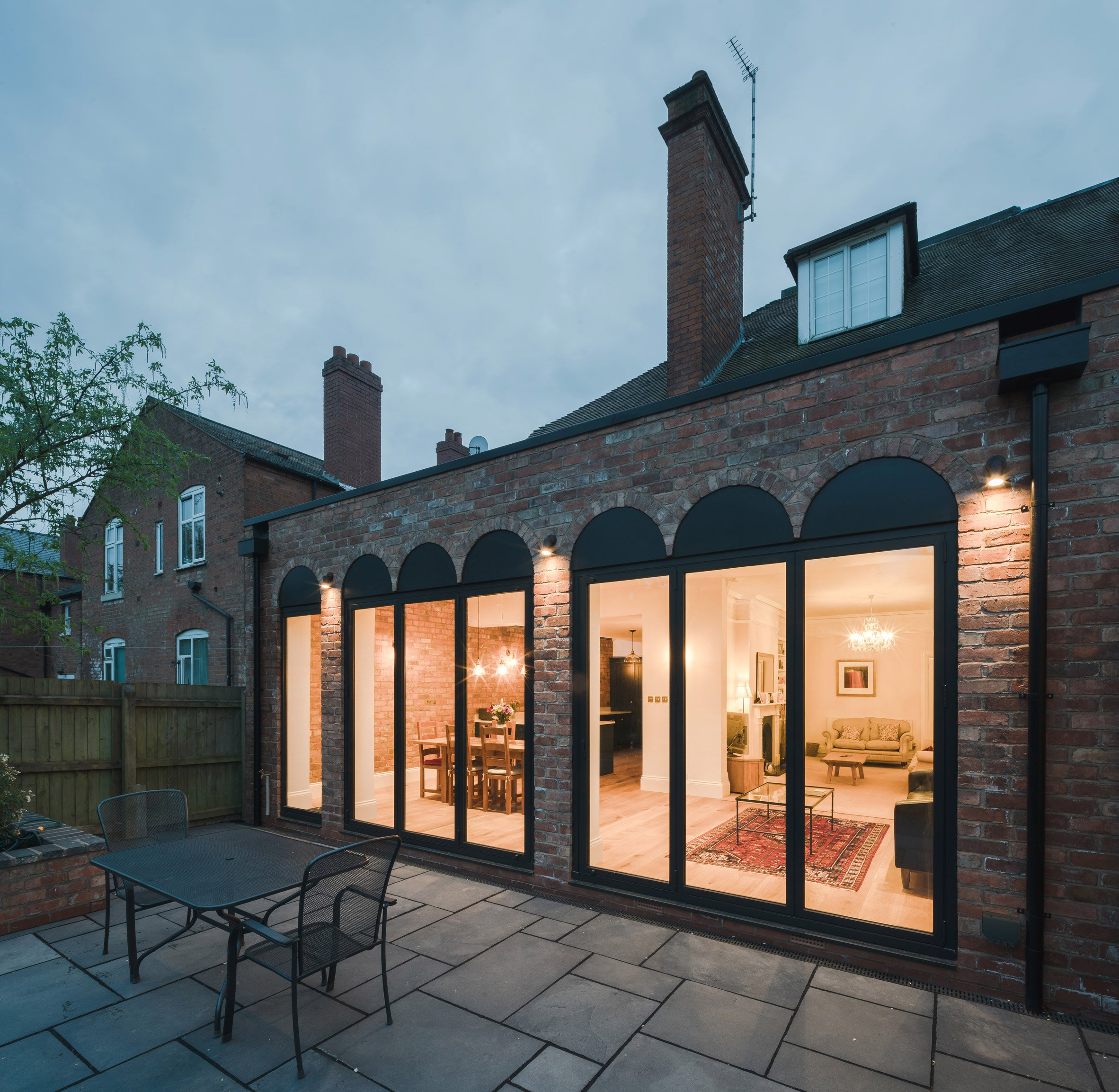 Colonnade-like glazing fronts Birmingham house extension by Intervention Architecture