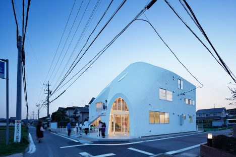 MAD transforms Japanese house into curvaceous kindergarten with a slide along one wall