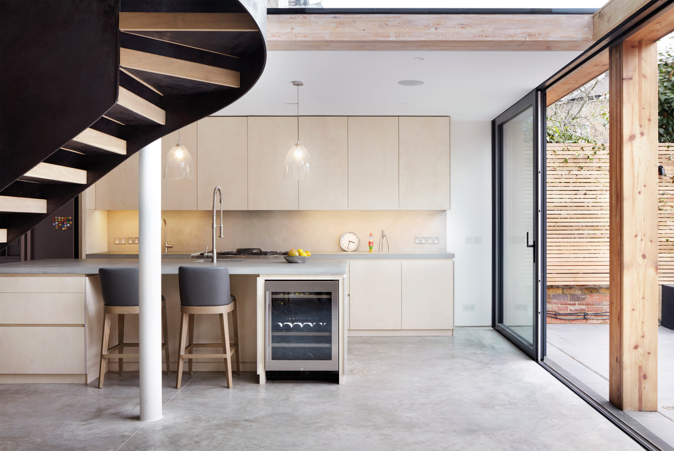 Cousins & Cousins adds laminated timber and glass extension to brick house in Hackney