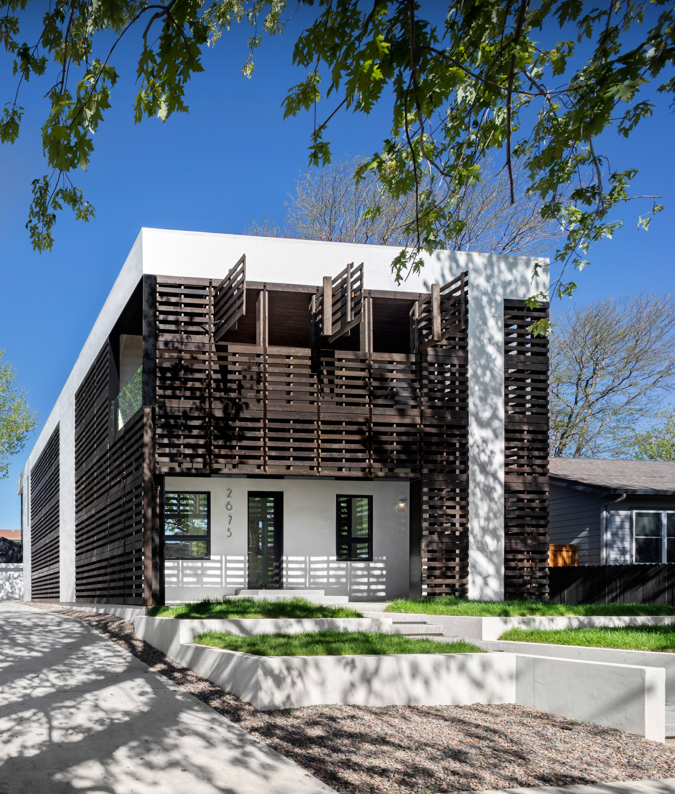 Meridian 105's Denver house features screens and shutters made of black wooden pallets