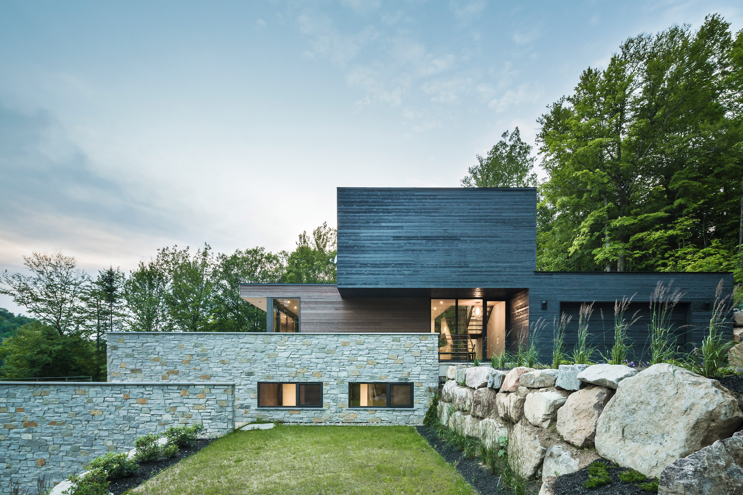Quebec home by MU Architecture responds to steep and rocky topography
