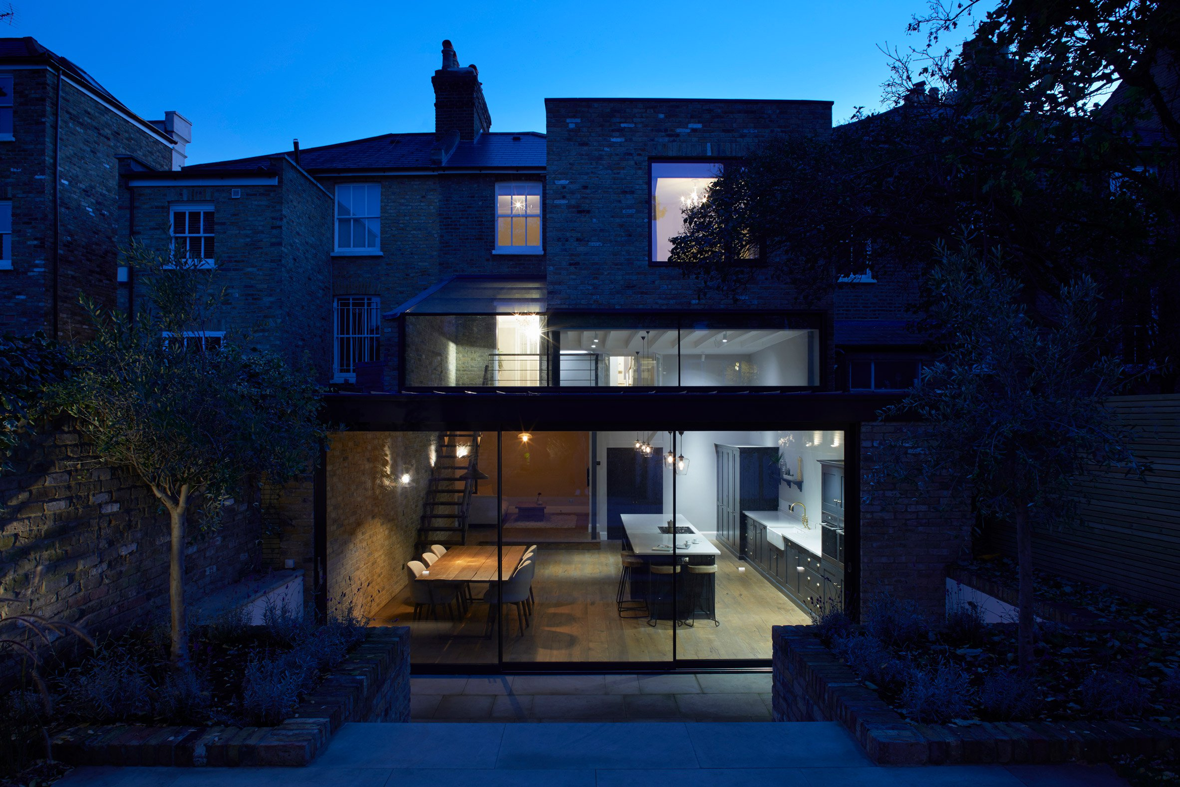 Giles and Pike Architects adds stepped glass extension to Victorian house in south London
