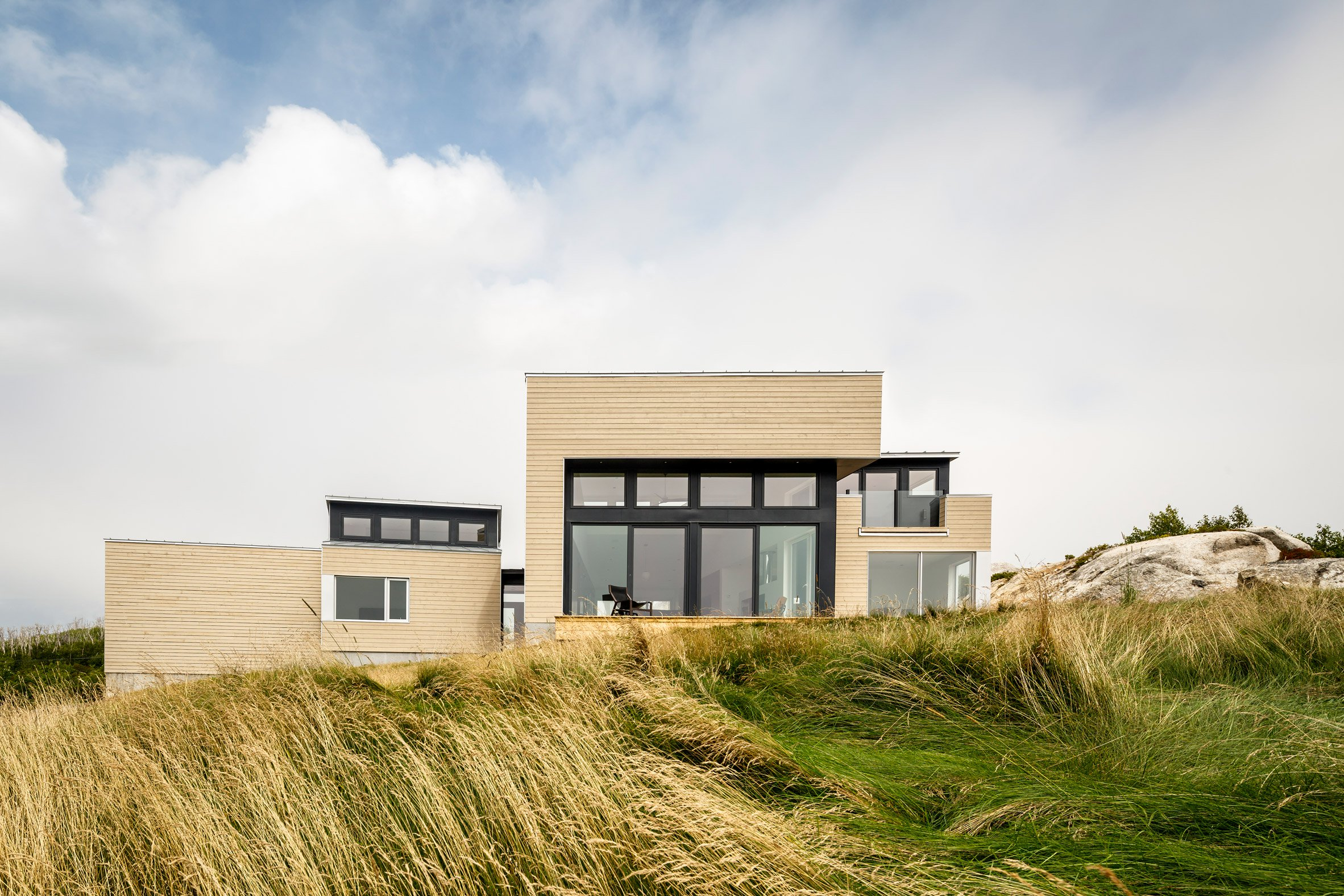 Nova Scotian house by Omar Gandhi Architect sits between rocky outcrop and expansive views
