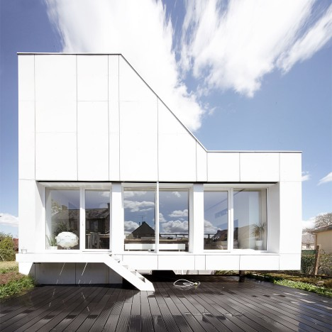 Converted shipping containers combine to form angular Flying Box house
