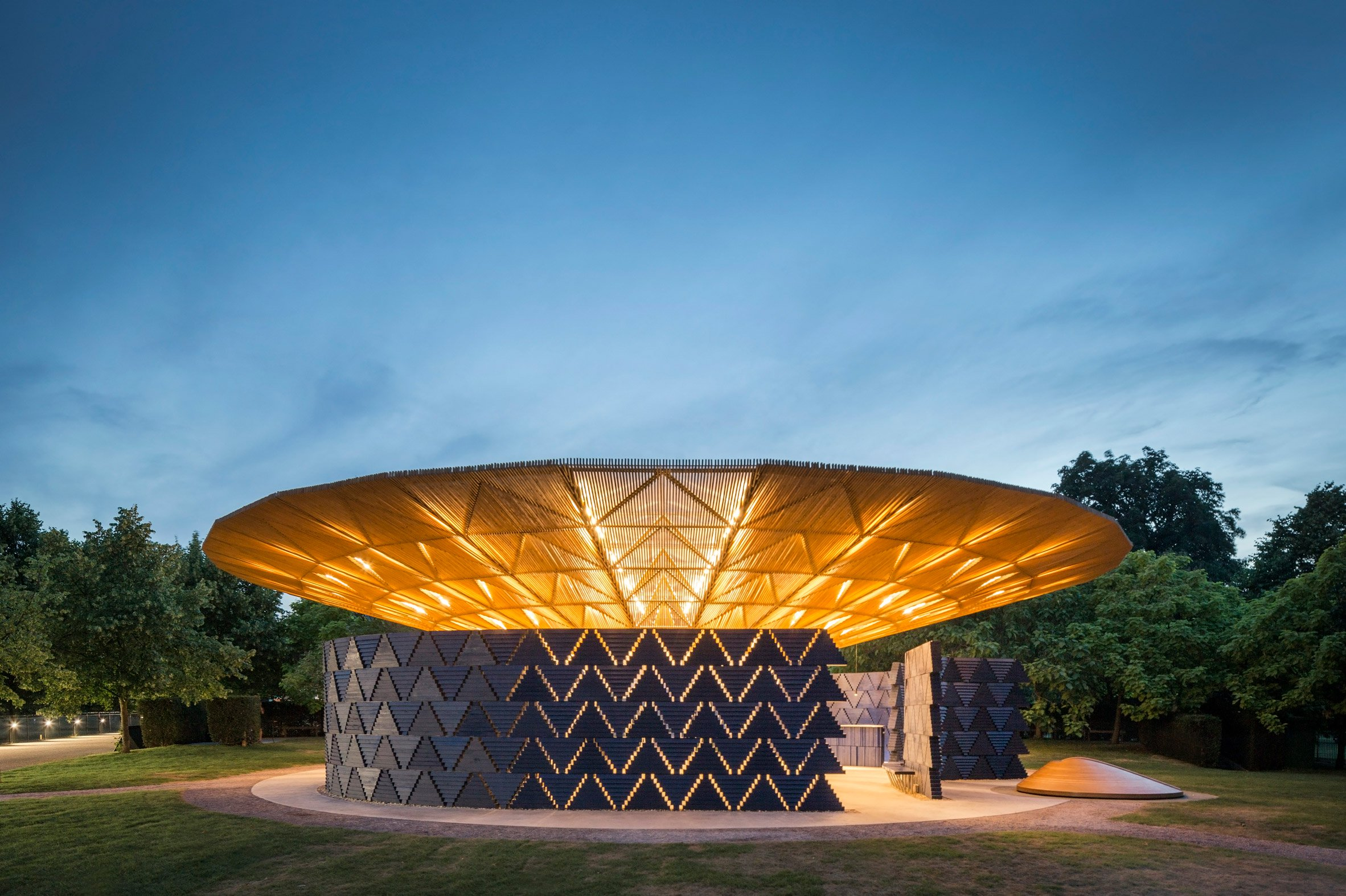 """Serpentine Pavilion glows at night to """"attract people to come and celebrate"""" says Diébédo Francis Kéré"""