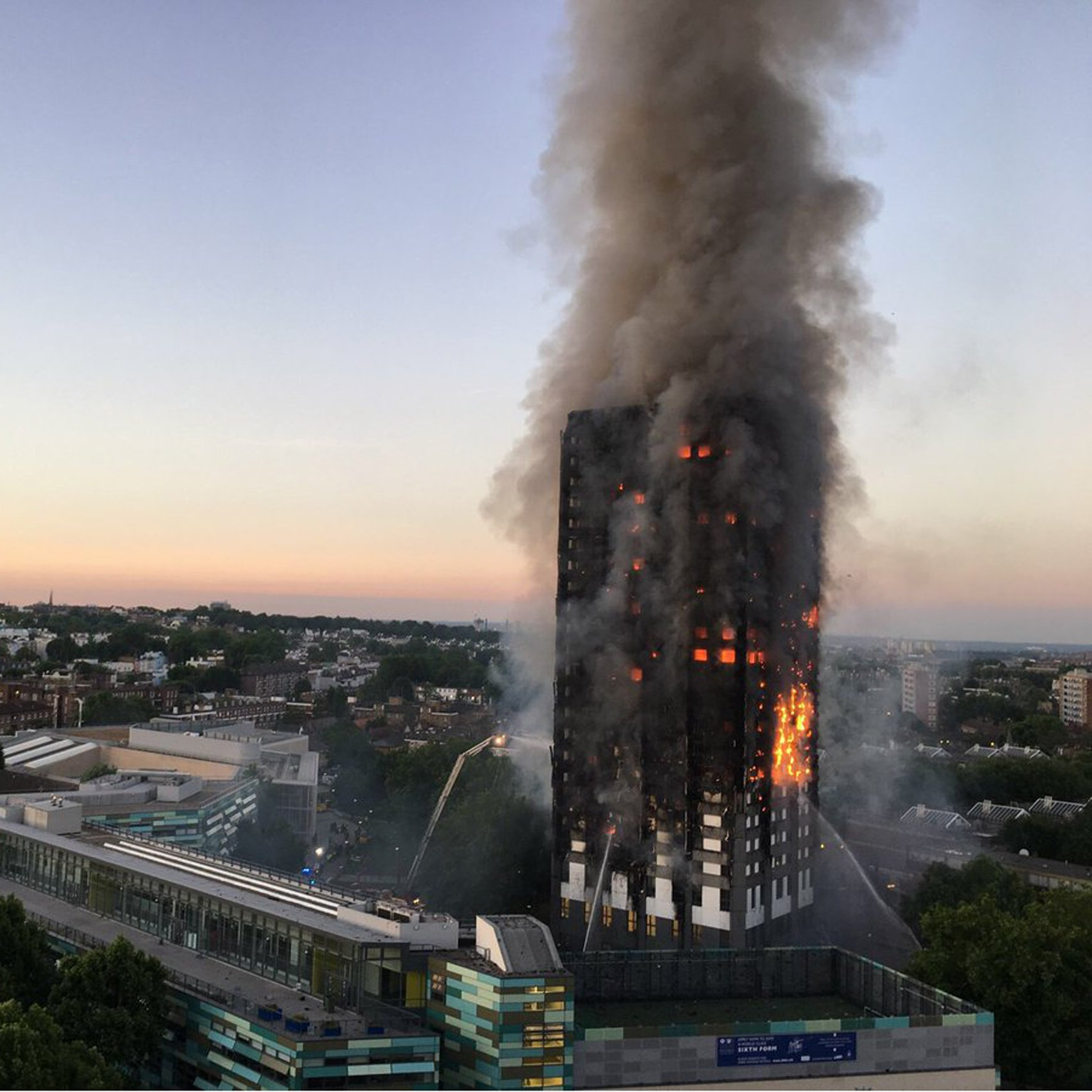 Theresa May orders public inquiry into Grenfell Tower fire as renovations blamed