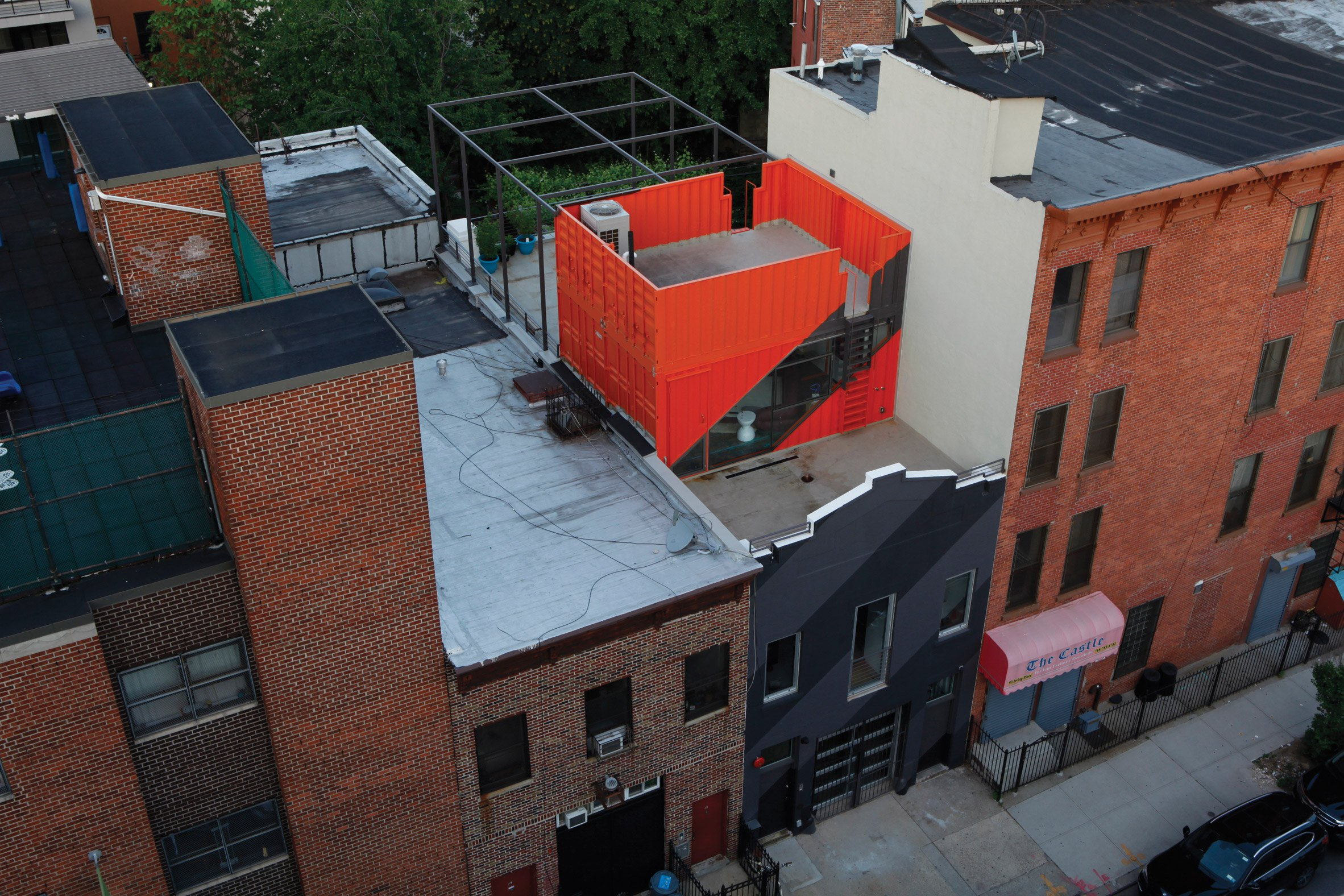 Lot-Ek uses shipping containers to overhaul Brooklyn carriage house