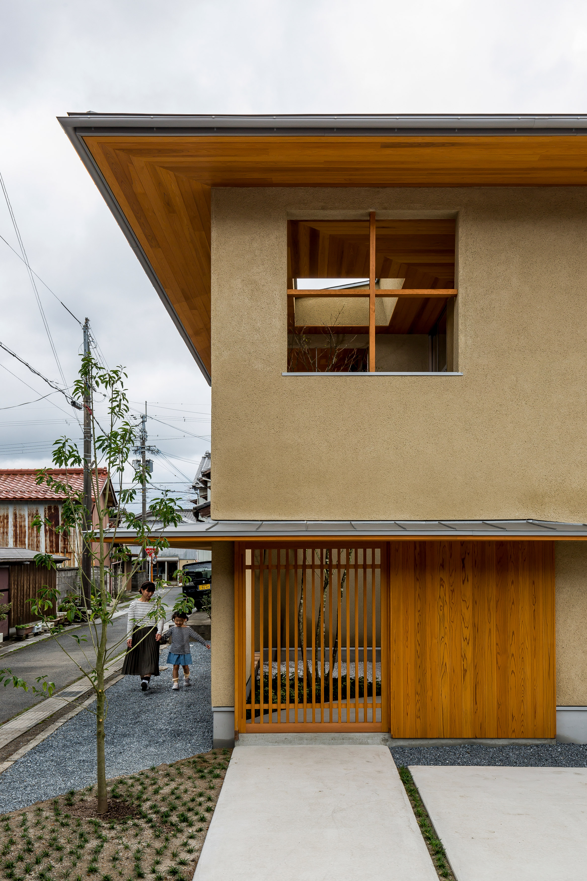 Hearth Architects designs family house in Shiga with tree-planted atrium