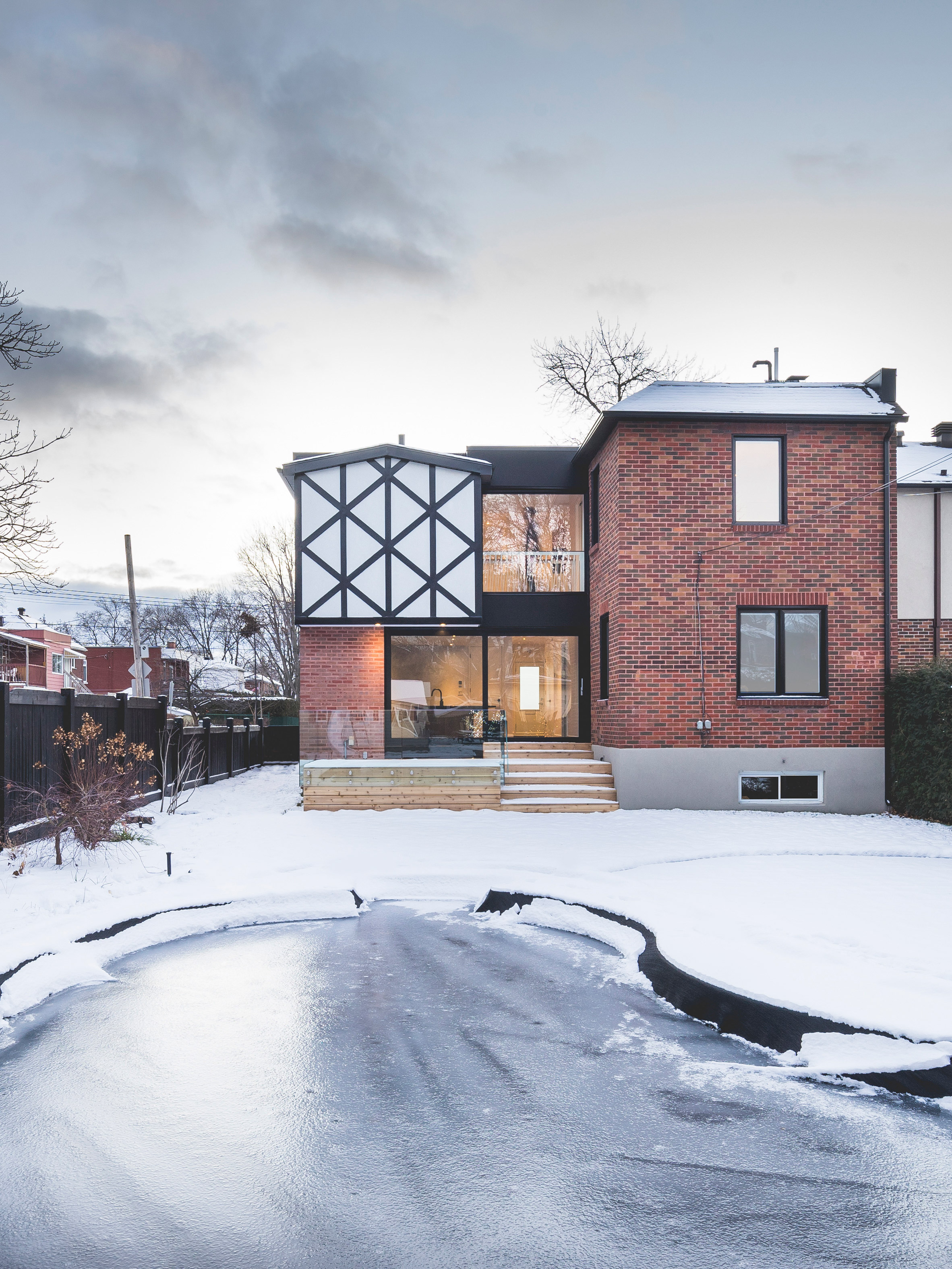 L McComber Architects gives contemporary update to Tudor-style home in Montreal